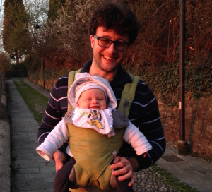 A happy dad (also professionally) and his happy son. Baby carrier courtesy of Amazon and the SUSE Manager team!!!